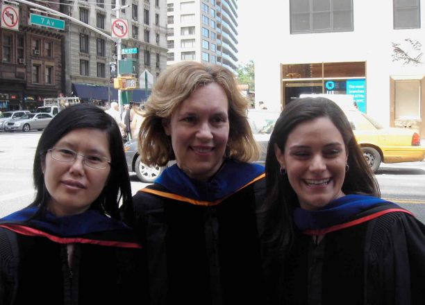 Dr. Gudas standing with graduates on 7th Avenue.