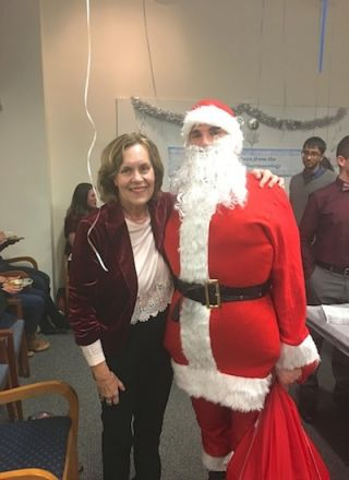 Dr. Gudas with Santa.