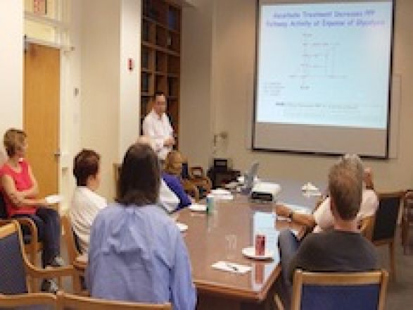 Dr. Changyuan Lu speaks at the faculty lunch seminar in the Pharmacology Dept on September 29, 2015.