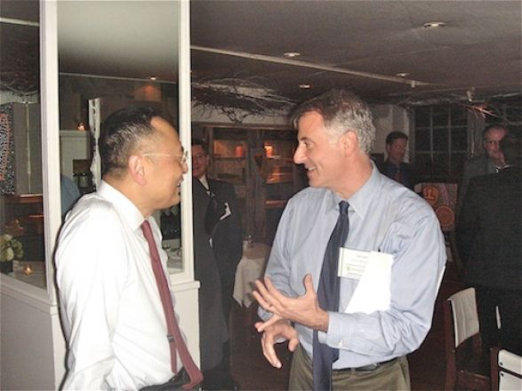 Dr. Gerald Chan talks with Dr. Nico Schiff of Weill Cornell at the dinner the night before the symposium.