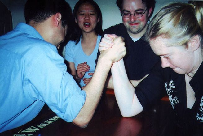 Students arm wrestling.